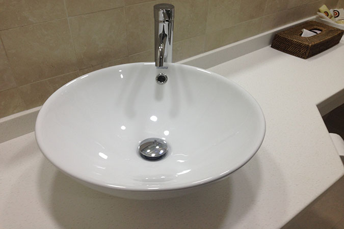 Bowl Shaped Sink installed to Complement White Vanity